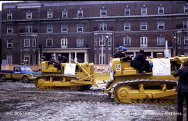 Men on bulldozers
