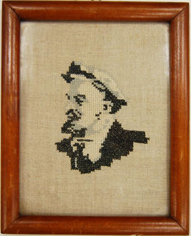 Cross stitch of Lenin in wood frame