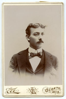 Portrait of a young man with moustache and bowtie
