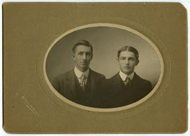 Portrait of two young men in suits