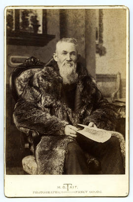 Portrait of a man in fur coat