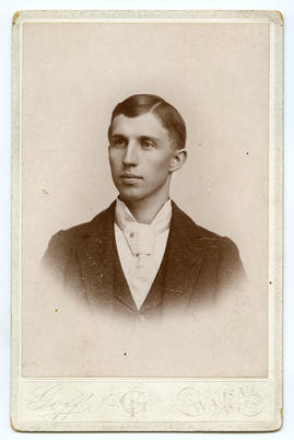 Portrait of a young man with large tie