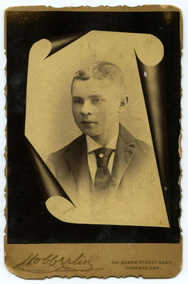 Portrait of a young man (J? Preston) framed by a scroll