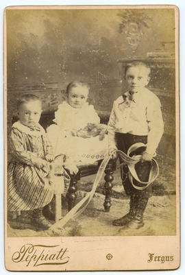Portrait of three children with toys