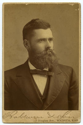 Portrait of man with beard and checkered bowtie