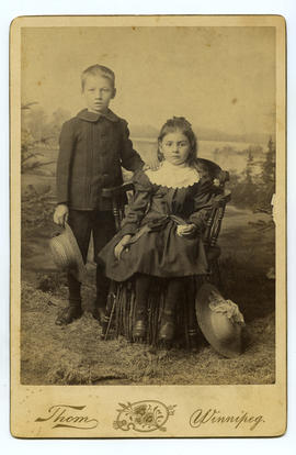 Portrait of boy and girl in outdoor scene